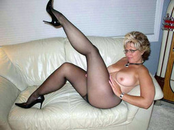 Long legged MILF on high heels posing..