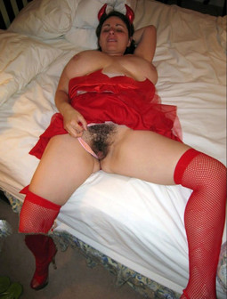Fat mature lady in a red suit, the..